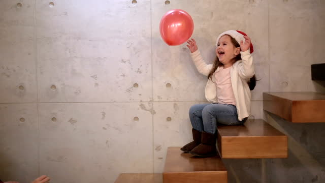 Playing with a balloon