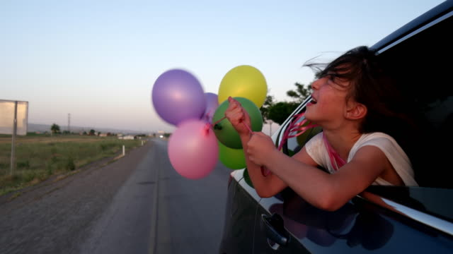 playing with balloon on car - daydreaming stock videos and b-roll footage