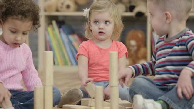 playing with blocks together - preschool student stock videos and b-roll footage