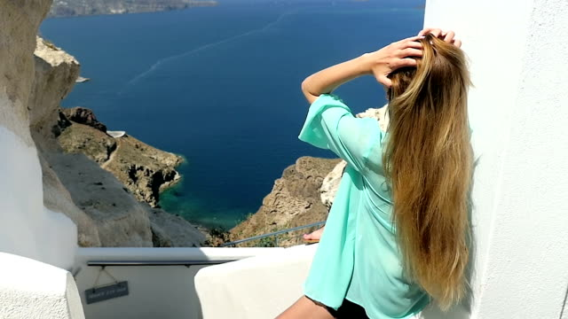 playing with hair & beauty in santorini - santorini stock videos and b-roll footage