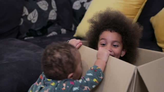 playing with my sister - cardboard box stock videos & royalty-free footage