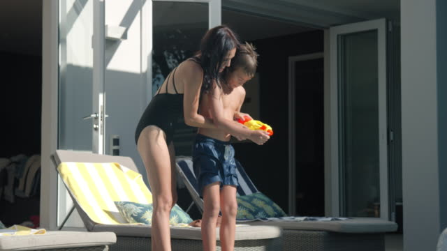 playing with squirt gun - squirt gun stock videos and b-roll footage