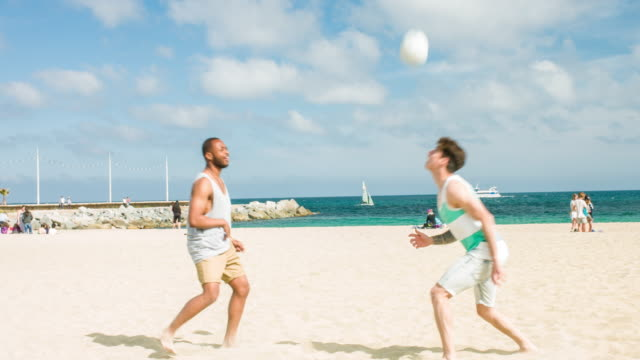 playing with the ball in the beach - 20 29 years stock videos & royalty-free footage