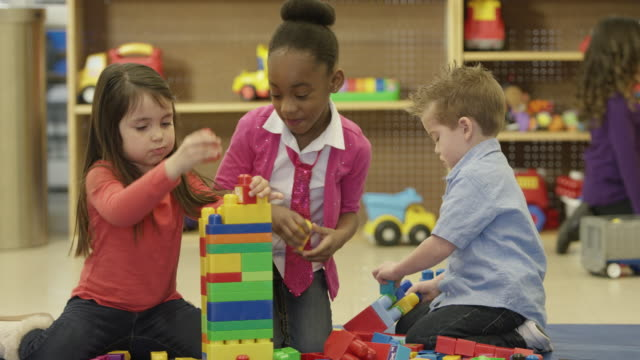 playing with toy blocks - preschool stock videos and b-roll footage