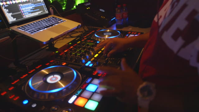 dj plays music at chilean nightclub, close-up - dance music stock videos & royalty-free footage