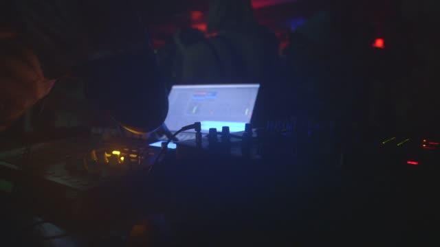 dj plays music in club as people dance - club dj stock videos & royalty-free footage