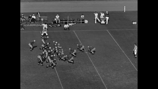 vídeos de stock e filmes b-roll de vls plays with ucla bruins running backs jackie robinson and kenny washington running ball / washington faking toward quarterback as fullback bill... - 1939