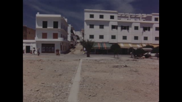 Plaza and surrounding buildings and cafes in Ibiza in Spain circa 1965