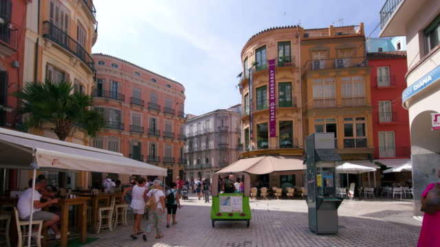 plaza carbon street scene, malaga, andalusia, spain - tricycle stock videos & royalty-free footage