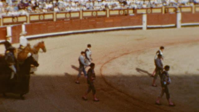 plaza de toros entrance / bullfighters enter ring / bull chases matador / sevilla scenic / archival bullfighting ring on july 01 1955 in madrid spain - bullfighter stock videos & royalty-free footage