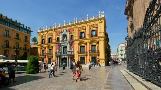 vídeos de stock e filmes b-roll de plaza del obispo & palacio episcopal, malaga, andalusia, spain - rua principal rua