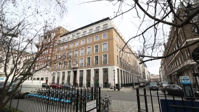 stockvideo's en b-roll-footage met bp plc headquarters viewed from park in centre of st james's square in london bp plc office hq viewed from opposite side of road cars pass by office... - bp