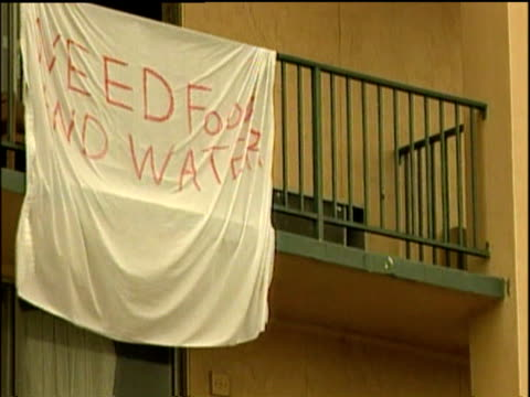 plea for help on bed sheet hanging over balcony of hotel building following hurricane katrina 01 sep 05 - pleading stock videos & royalty-free footage