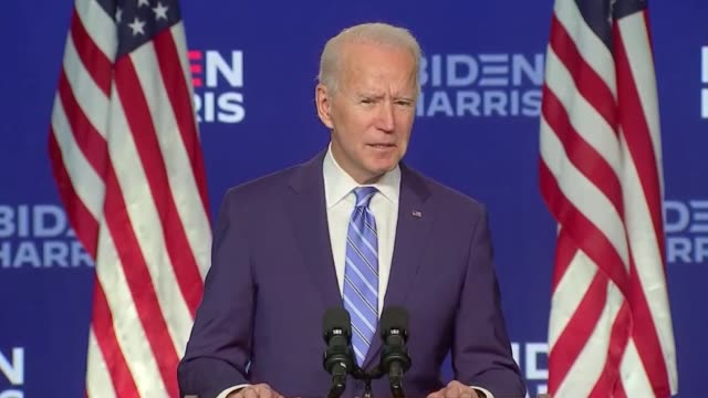 stockvideo's en b-roll-footage met joe biden campaign joe biden has declared he is winning enough states to take the white house in america's knife-edge election as the key... - us president
