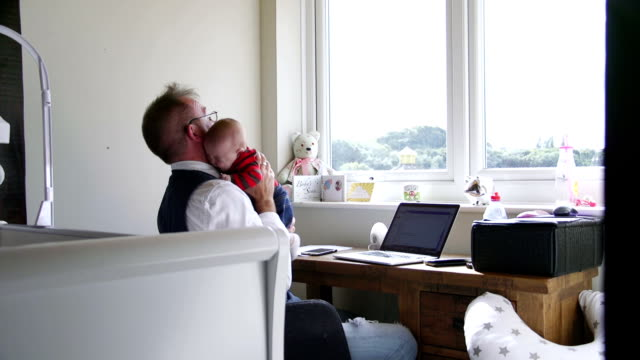 please stop crying so daddy can work - teleworking stock videos and b-roll footage