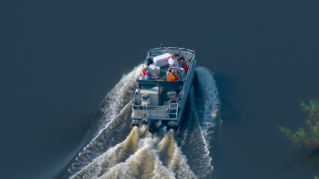 A pleasure boat moves along an estuary of the Gulf Islands National Seashore.
