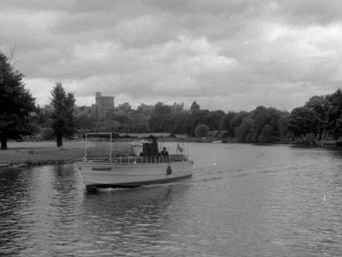 A pleasure cruiser moves along the River Thames near Windsor Castle