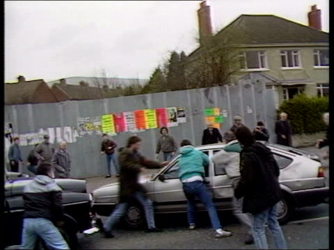 ira pledge to lay down their weapons history lib mob attack car of british soldiers corporals derek wood and david howes - david howes stock videos & royalty-free footage