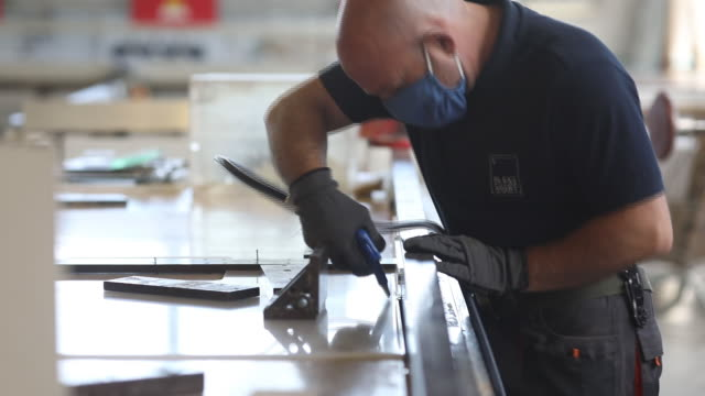 plexismart srl, an acrylic glass manufacturer in guidonia, close to rome, italy, on wednesday, may 20, 2020. - lavoro manuale video stock e b–roll