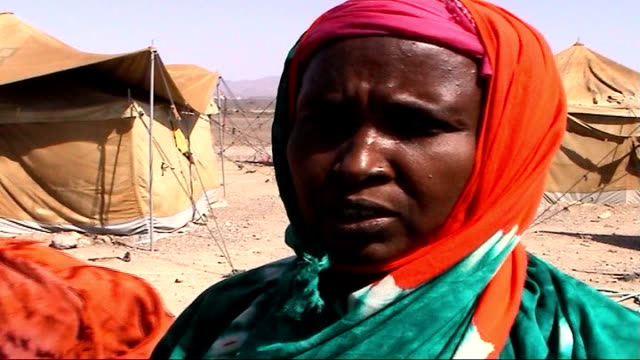 Plight of Somali refugees EXT Women collecting water in container from tap in refugee camp Containers Nadifo Ali Mohammed interview SOT We left...