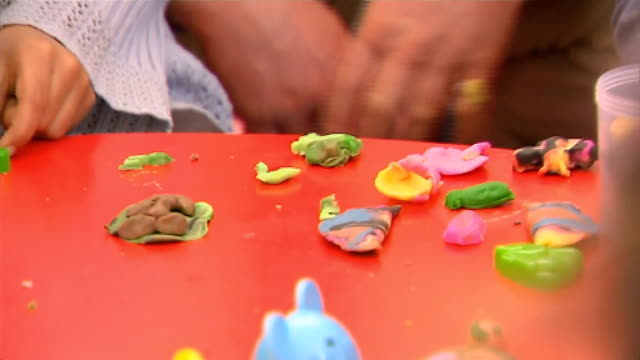 Plight of Syrian refugees / Prince of Wales visits Syrian refugee camp on Jordanian border Children making trees with plasticine with Prince Charles...