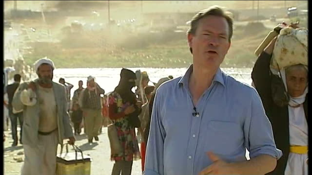 plight of yazidi people trapped on mount sinjar / helicopter carrying aid crashes; reporter to camera iraqi military helicopter taking off - sinjar mountains stock videos & royalty-free footage