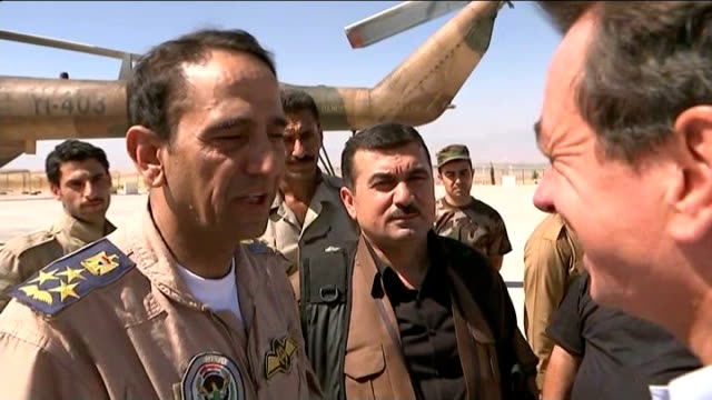 plight of yazidi people trapped on mount sinjar / helicopter carrying aid crashes; saadi putting on cap major general ahmed saadi interview sot -... - sinjar mountains stock videos & royalty-free footage