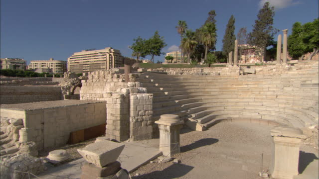 plinths, stone walls and stairs remain in a ruined alexandria ampitheater and street. - old ruin stock videos & royalty-free footage