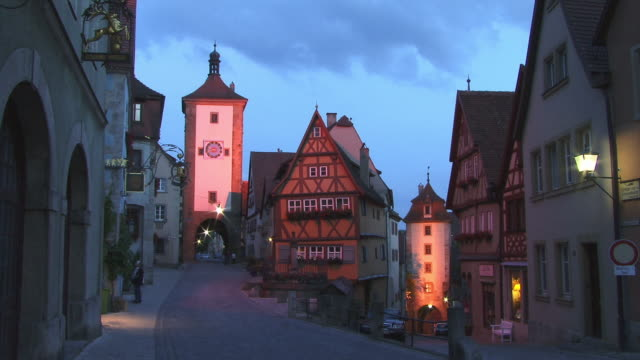 FAST MOTION, WS, Plonlein (little square) with Sieber Tower and Kobolzeller Tower at dusk, Rothenburg ob der Tauber, Franconia, Bavaria, Germany