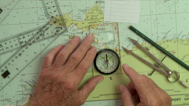 plotting a sailing course with chart and compass - planning stock videos & royalty-free footage