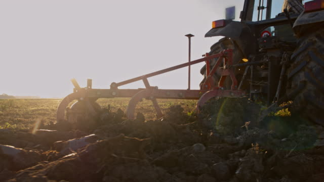 cu plow turning over the soil - tractor stock videos & royalty-free footage