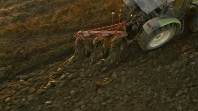 aerial plowing a field with the tractor - plowed field stock videos and b-roll footage