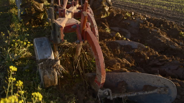 slo mo plowing the field with a tractor - plough stock videos & royalty-free footage