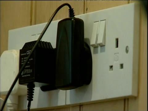 vídeos y material grabado en eventos de stock de plugs inserted into mains sockets and switched on england; 2006 - enchufe