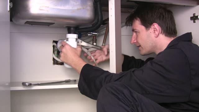 plumber at work - plumbing stock videos & royalty-free footage