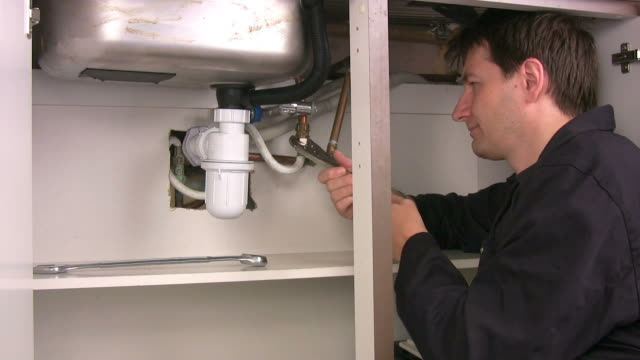plumber at work - one mid adult man only stock videos & royalty-free footage
