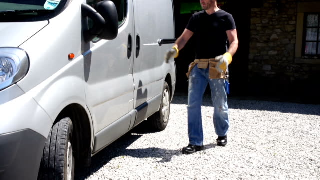 hd crane: plumber / handyman, electrician, collects tools from van - craftsman stock videos and b-roll footage