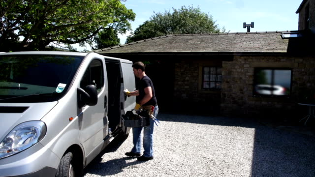 hd crane: plumber / handyman gettings tools out of van - van vehicle stock videos and b-roll footage