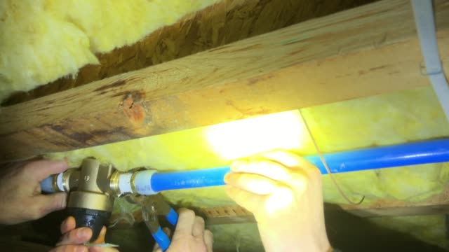 plumber is attaching water pressure regulator at the home basement - home basement stock videos and b-roll footage