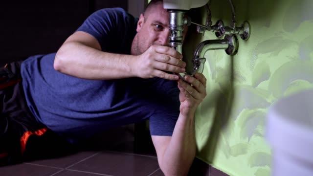 plumber repairing a drain - plumber stock videos & royalty-free footage