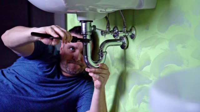 plumber repairing a siphon - bathroom sink stock videos & royalty-free footage