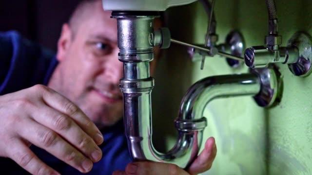 plumber repairing a siphon - plumber stock videos & royalty-free footage
