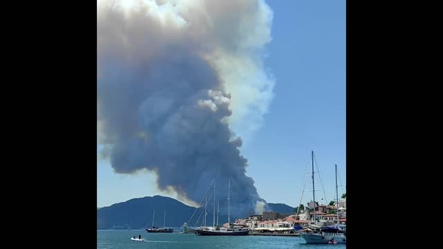 plume of smoke was seen rising into the air on july 29 as a wildfire approached the turkish coastal resort of marmaris. turkish news outlet... - tourist resort stock videos & royalty-free footage