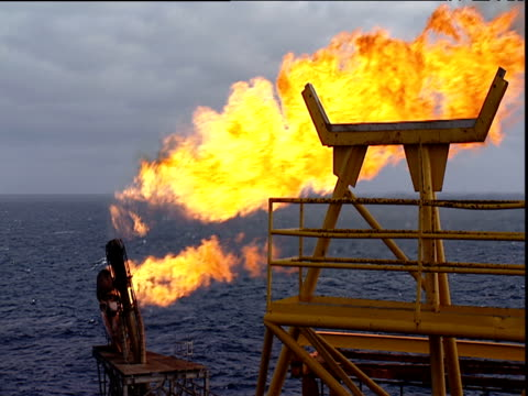 plumes of burn off flares emerging from north sea oil rig north sea - oil industry stock videos & royalty-free footage