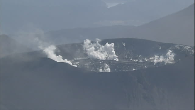Plumes of smoke rise from the crater of Mt. Shinmoe in Japan.