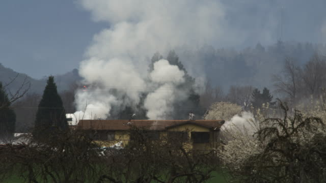 plumes of smoke rise from under the roof of a burning house - myrtle creek stock videos & royalty-free footage