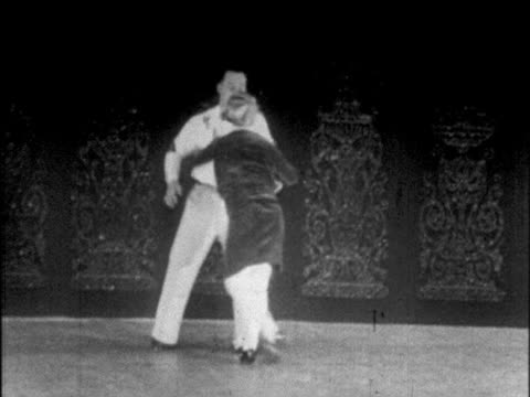 B/W 1925 plump couple dancing on stage / Chicago / newsreel