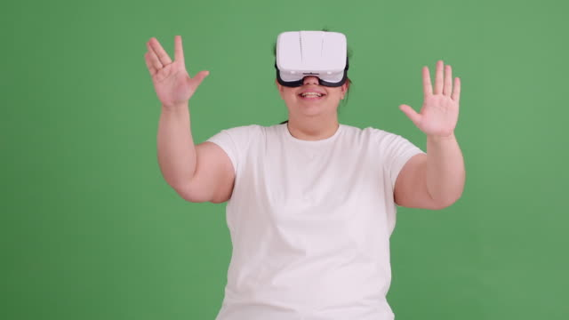 plump girl with glasses of virtual reality on green screen - model t stock videos and b-roll footage
