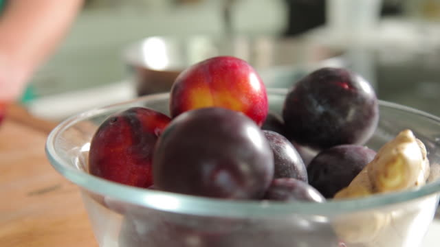 plums on a clear bowl - pflaume stock-videos und b-roll-filmmaterial