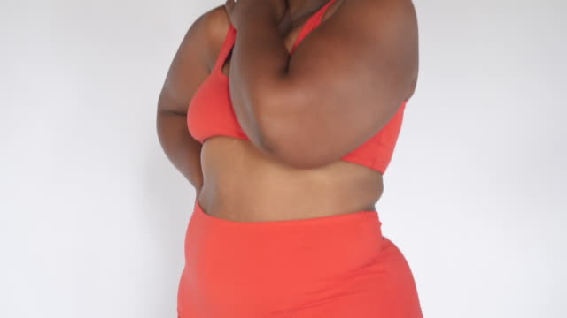 plus size woman posing in underwear and smiling - the human body stock videos & royalty-free footage